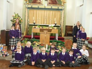 Pictured in Chapel are Sharon Owen, Head of Lower School, Shan Morgan, Deputy Head of Lower School and Lower School pupils.